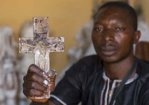 Benin, West Africa, Bonhicon, kagbanon bebe priest holding a crucifix during a voodoo ceremony