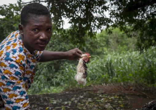 Benin, West Africa, Dankoly, a voodoo priest holding a chichen cut head