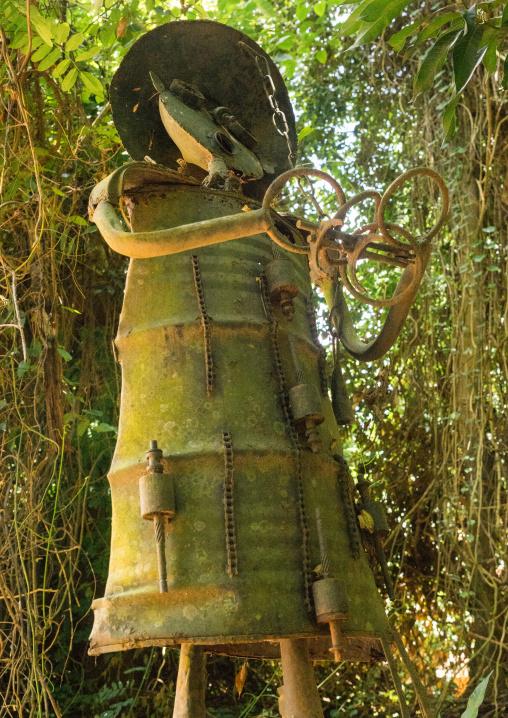 Benin, West Africa, Ouidah, ogun gof of war voodoo statue in the sacred forest of kpasse