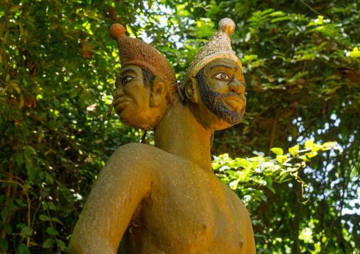 Benin, West Africa, Ouidah, statue of 3-headed voodoo deity in sacred forest of kapasse