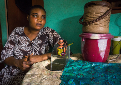 Benin, West Africa, Ouidah, tatiana takes cares of the carved wooden figure of her daughter paterna