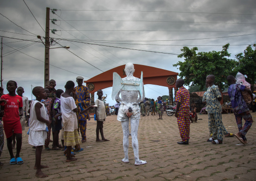 Benin, West Africa, Savalou, man disguised as an angel collecting money in the street