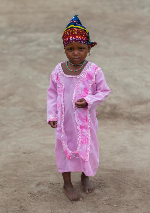 Benin, West Africa, Savalou, fulani peul tribe little girl in pink dress