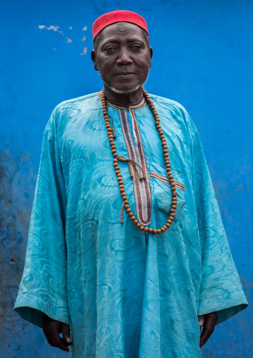 Benin, West Africa, Copargo, zachary muslim man standing in front of a blue wall