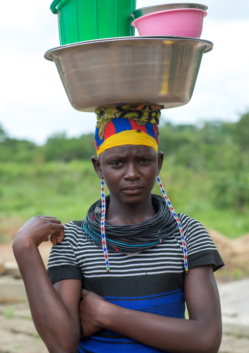Benin, West Africa, Taneka-Koko, a fulani peul tribe woman carrrying buckets on her head