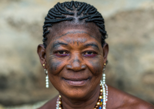 Benin, West Africa, Bopa, voodoo priestess with tattooed face during a ceremony
