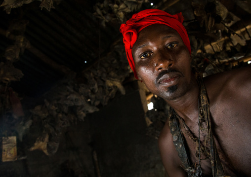 Benin, West Africa, Bopa, scary voodoo adept with a red scarf during a ceremony