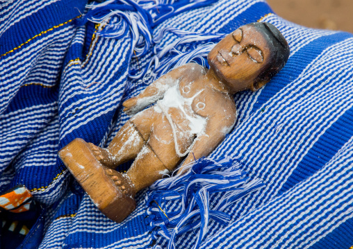 Benin, West Africa, Bopa, miss hounyoga washing the carved wooden figures made to house the soul of her dead twins