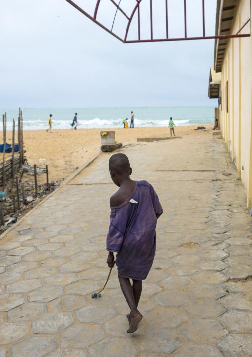 Benin, West Africa, Cotonou, boy playing on the beach