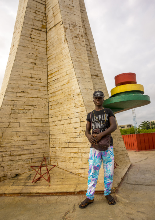 Benin, West Africa, Cotonou, man pausing in front of the red star square