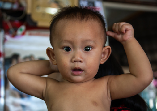 Portrait of a shirtless cambodian boy, Battambang province, Battambang, Cambodia