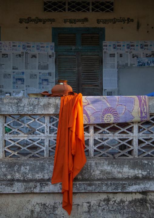 Robes hanging outside buddhist monastery, Battambang province, Battambang, Cambodia