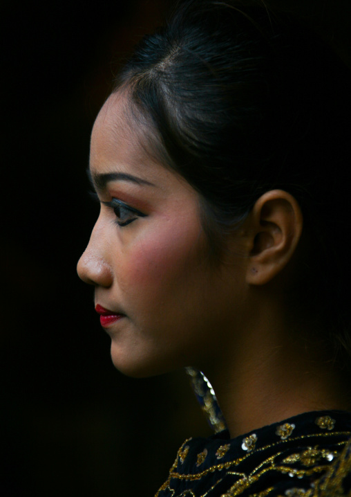 Side view of a cambodian dancer face during a training session of the National ballet, Phnom Penh province, Phnom Penh, Cambodia