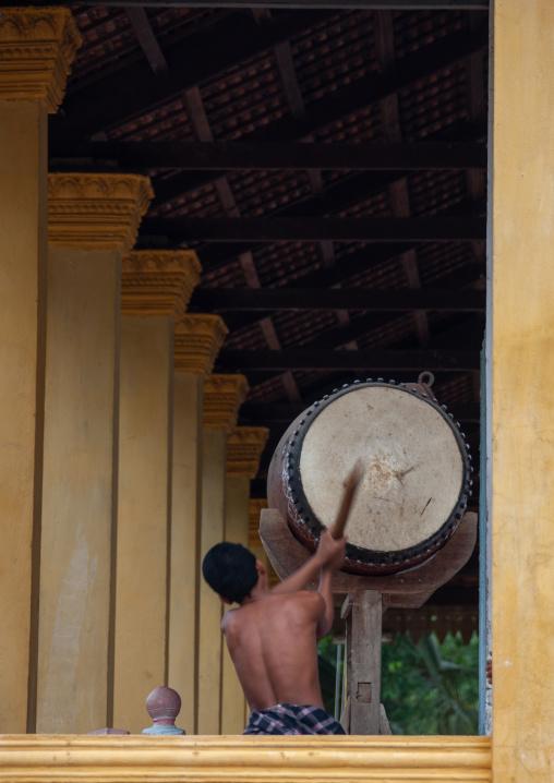 Buddhist monk beats drum in Angkor wat, Siem Reap Province, Angkor, Cambodia