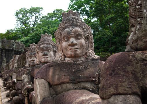 Sculptures at the way of Angkor wat entrance gate, Siem Reap Province, Angkor, Cambodia