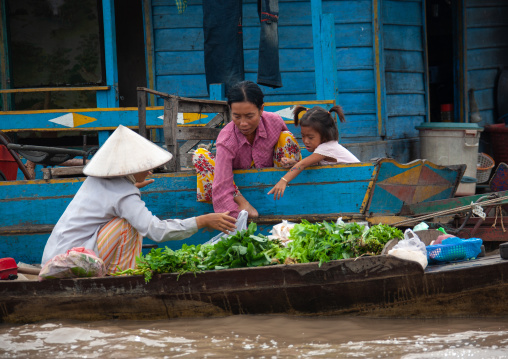 Cambodian women selling food on boats in the floating village on Tonle Sap lake, Siem Reap Province, Chong Kneas, Cambodia