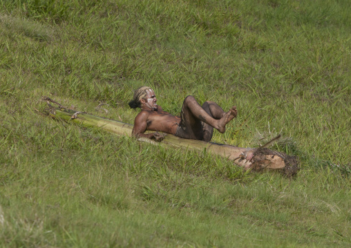 Man On Banana Trunk During Haka Pei Competition During Tapati Festival, Easter Island, Chile