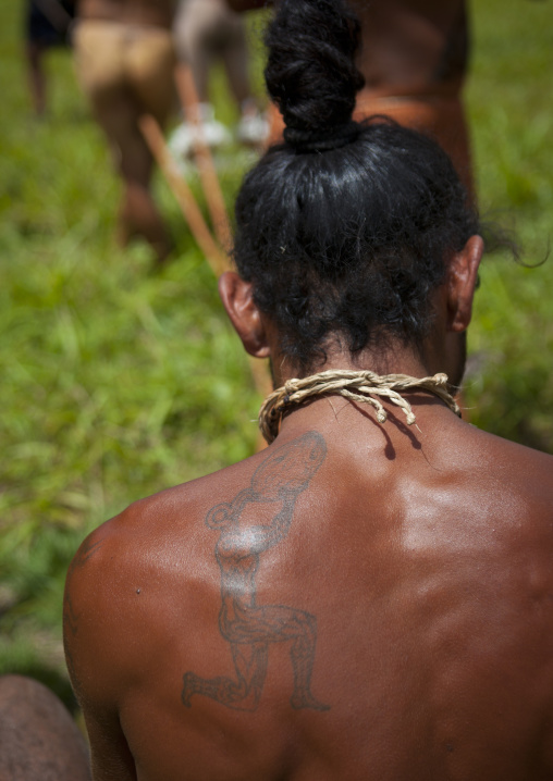 Tattoo On The Shoulder Of A Native Man, Easter Island, Chile