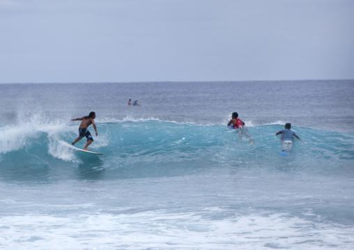 Surfers In  In Hanga Roa, Easter Island, Chile