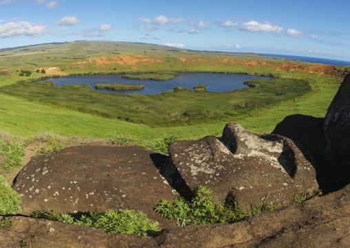 Lying Moai Over Rano Raraku Lake, Easter Island, Chile