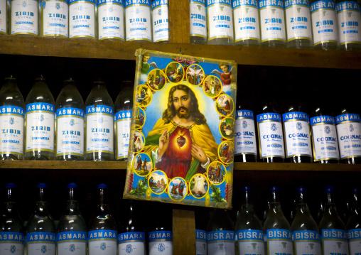 Jesus Poster In Front Of Zibib And Cognac Bottles, Central region, Asmara, Eritrea