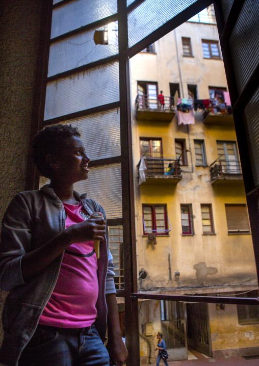 Girl Standing In Falletta Art Deco Building Stairs, Central region, Asmara, Eritrea