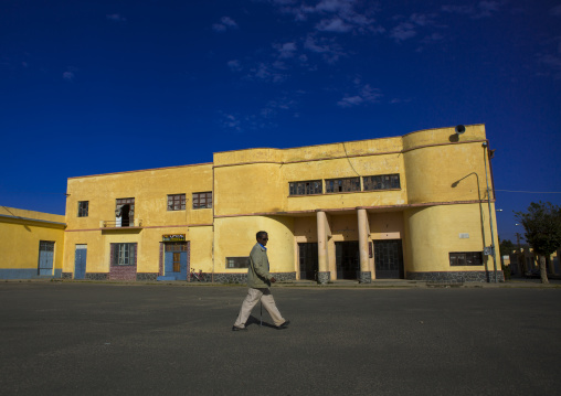 Man Passing In Front Of An Old Colonial Italian Cinema Theatre, Debub, Dekemhare, Eritrea