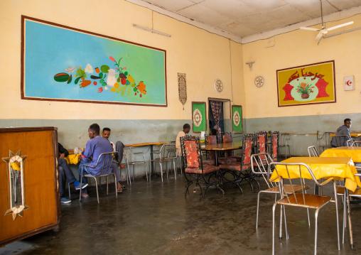 Eritrean men in a decorated restaurant, Semien-Keih-Bahri, Keren, Eritrea