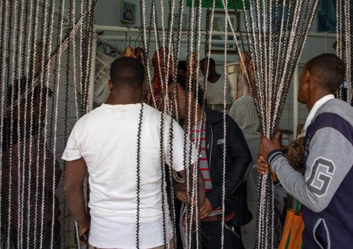 Eritrean men entering a butchery shop, Central region, Asmara, Eritrea