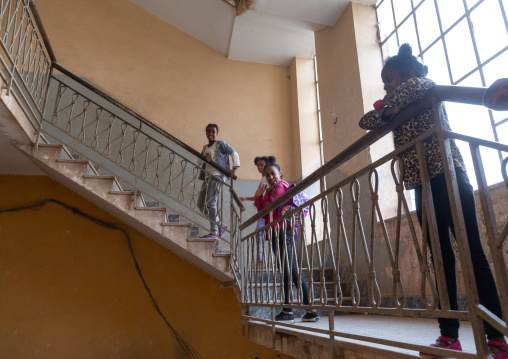 Eritrean girls in an old art deco style stairs from the italian colonial times, Central region, Asmara, Eritrea