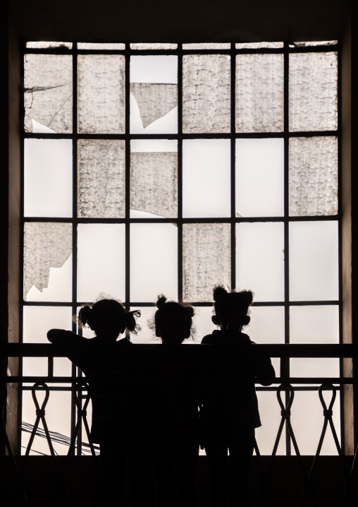Silhouettes of children standing in front of a huge window, Central region, Asmara, Eritrea