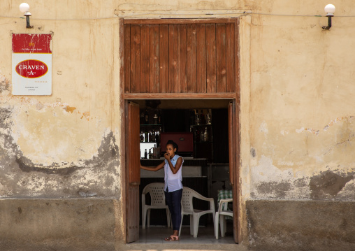 Eritrean woman at the entrance of a restaurant, Northern Red Sea, Massawa, Eritrea