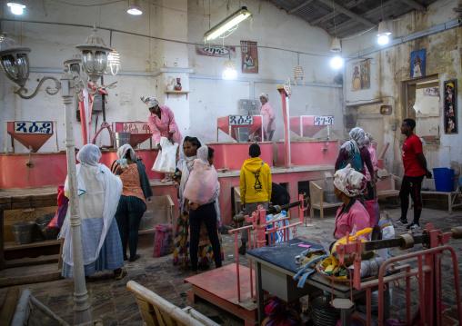 Eritrean people bringing grains to grind in a mill, Central region, Asmara, Eritrea