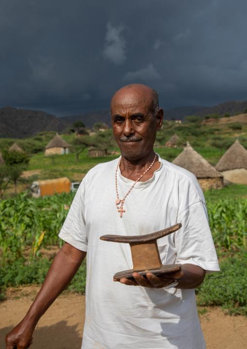 Bilen tribe with his wooden pillow, Semien-Keih-Bahri, Elabered, Eritrea