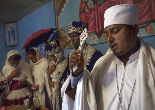 Priest singing during an Ethiopian wedding in an orthodox church, Zway, Ethiopia