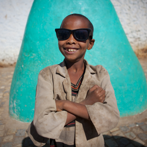 Portrait Of A Smiling Kid With Sunglasses In Harar, Ethiopia