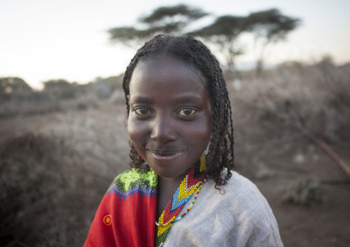 Portrait Of A Smiling Karrayyu Tribe Girl In The Country Side, Metehara, Ethiopia
