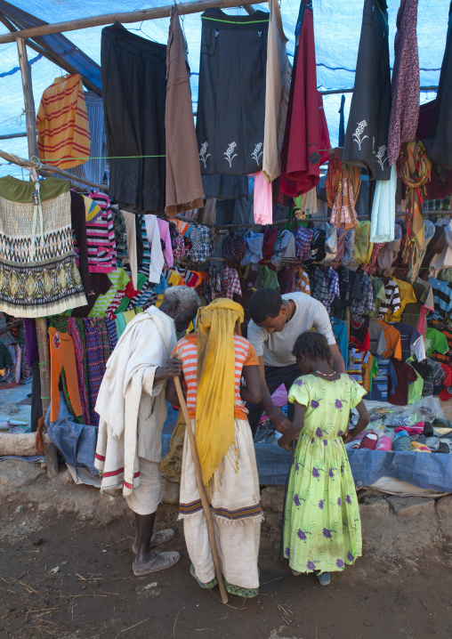 Karrayyu Tribe Family Looking At Goods On Display In Clothes Shop In Metahara Market, Ethiopia