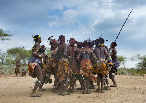 Hamer Tribe Women Celebrating Bull Jumping Ceremony By Dancing In Round, Omo Valley, Ethiopia