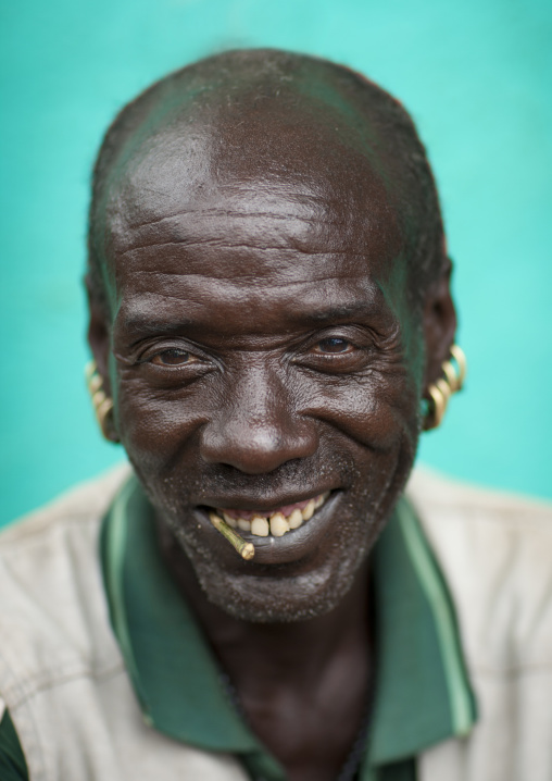 Senior Bana Man With Siwak Stick And Earrings Portrait Omo Valley Ethiopia