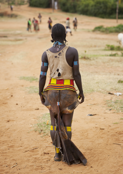 Tsemay tribe woman wearing a traditional suit at key afer market, Omo valley, Ethiopia
