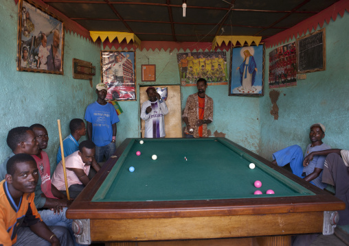 Men playing snooker pool indoors Ethiopia