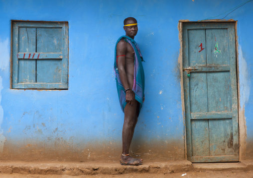Standing Bodi Man With Scarified Skin And Headband In Front Of House Hana Mursi Village Omo Valley Ethiopia