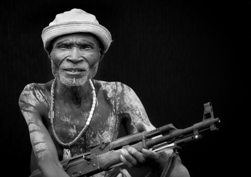 Senior Karo Man With Kalashnikov Rifle In Hand And Hat Ethiopia