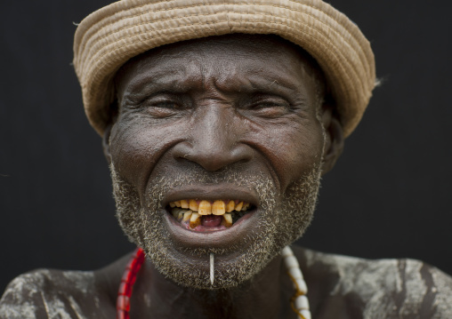 Portrait Of Senior Karo Man Yellow Teeth And Hat Ethiopia