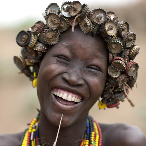 Young Smiling Dassanech Woman Wearing Bottle Caps Headdress Portrait Omo Valley  Ethiopia