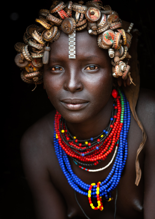 Portrait Of A Young Dassanech Cute Woman Wearing Bottle Caps Headgear And Beaded Necklaces Omo Valley Ethiopia
