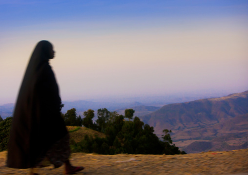 Silhouette Of A Woman Walking Along The Road Over Beautiful Landscape, Metehara, Ethiopia