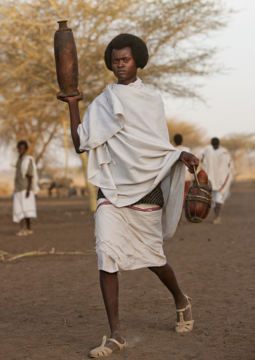 Young Karrayyu Tribe Man In Traditional Clothes And With Gunfura Hairstyle Bringing Gifts For The Gadaaa Ceremony, Metahara, Ethiopia