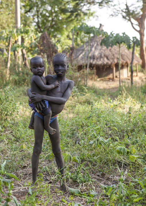 Anuak Child Holding A Baby In Abobo, The Former Anuak King Village, Gambela Region, Ethiopia